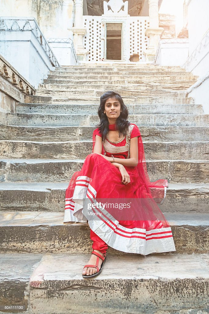 Beautiful indian bollywood model sitting on stairway of Jagdish Temple : Stock Photo
