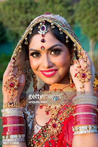 Beautiful Indian Bride In Traditional Wedding Dress Stock Photo