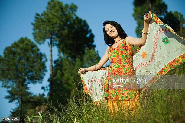 beautiful indian girl flying dupatta like her wings in nature. - 18 19 years stock pictures, royalty-free photos & images