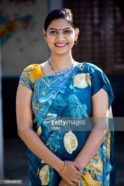 beautiful indian woman in sari - sari stock pictures, royalty-free photos & images