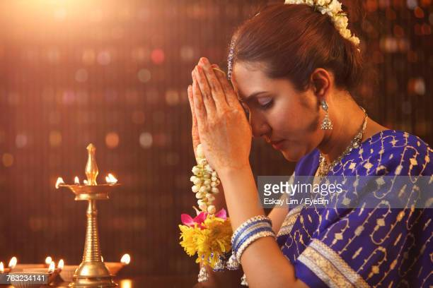 Beautiful Indian Woman In Sari Praying During Diwali