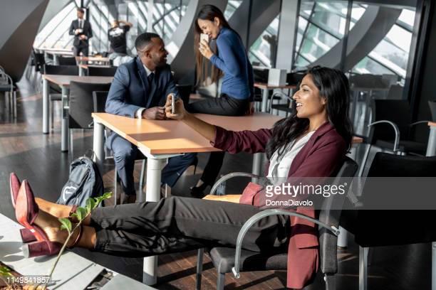 Beautiful Indian woman texting during the seminar break