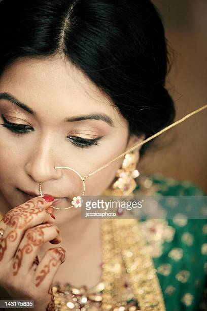 beautiful indian woman with gold jewelry - nose piercing stock pictures, royalty-free photos & images