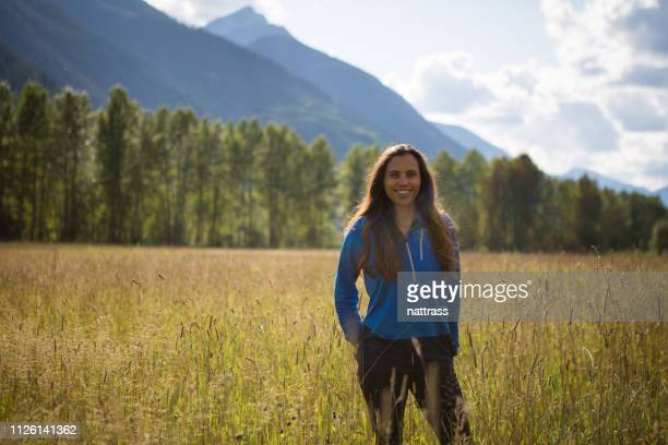 beautiful indigenous canadian woman standing in a field - first nations stock pictures, royalty-free photos & images