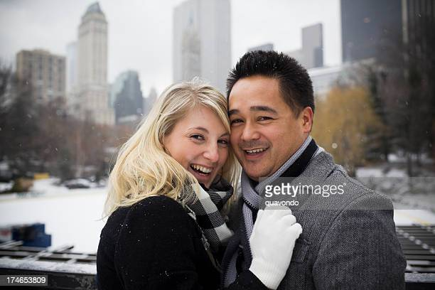 Beautiful Interracial Couple Embracing in Snowy Central Park, Copy Space