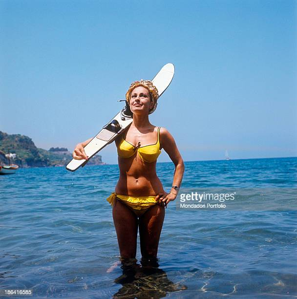 Beautiful Italian actress Silvana Pampanini poses standing in the sea and holding a waterski on her shoulder in the first half of the Fifties she...
