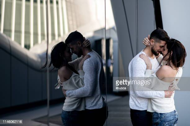 Beautiful Italian couple lifestyles in modern urban environment: Romantic moment