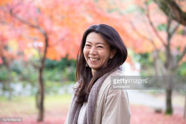 beautiful japanese woman enjoying autumn - east asian culture stock pictures, royalty-free photos & images
