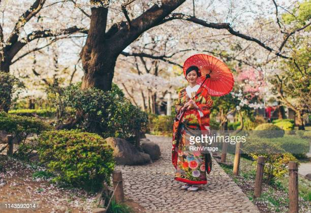 beautiful japanese woman in kimono - tradition stock pictures, royalty-free photos & images
