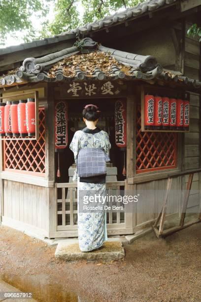Beautiful Japanese woman wearing kimono praying