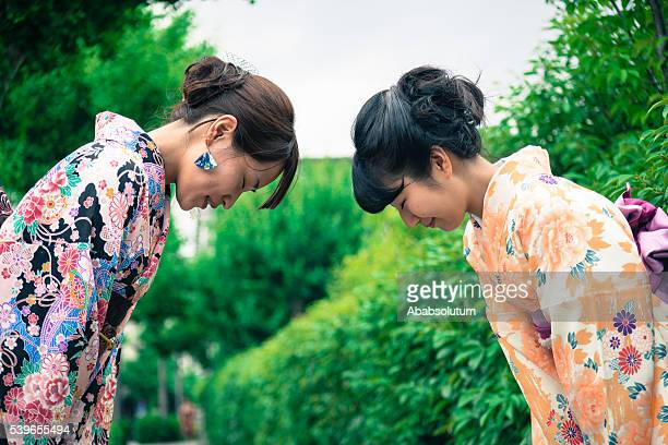 beautiful japanese women in kimono bowing, kyoto, japan - period costume stock pictures, royalty-free photos & images