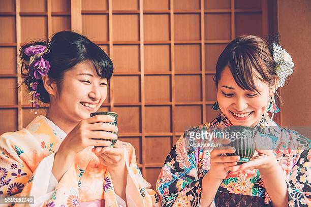 Beautiful Japanese Women in Kimono Drinking Matcha Tea, Kyoto, Japan