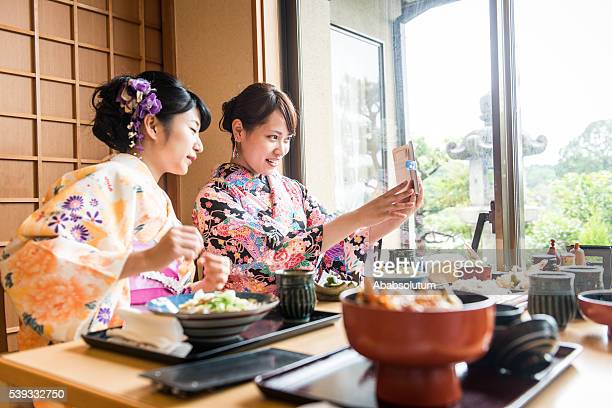 beautiful japanese women in kimono taking selfie, kyoto, japan - zen like stock pictures, royalty-free photos & images