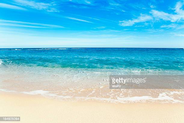 beautiful kauai perfect beach inviting blue water and sky - skinny dipping stock photos and pictures