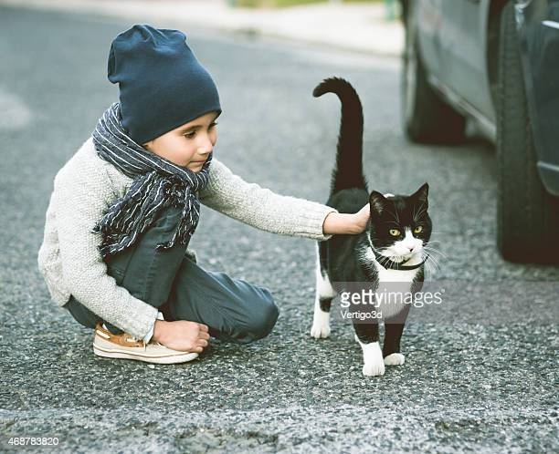 Beautiful kid play with cat