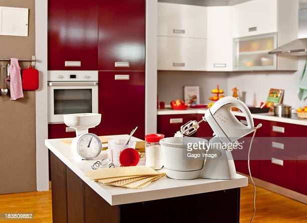 A beautiful kitchen with a mixer and ingredients on counter