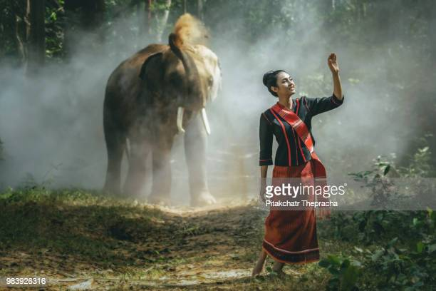 Beautiful Kui girl in indigenous dress. The backdrop is elephant and jungle. Elephant Village...