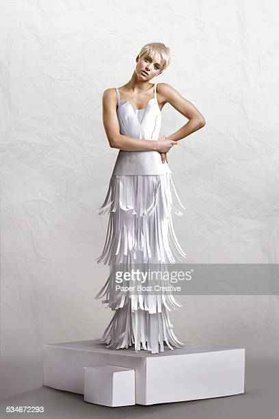 Beautiful lady in long white paper craft dress
