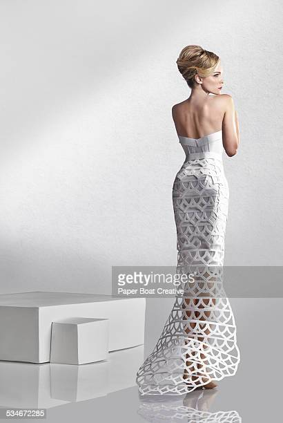 Beautiful lady in white paper craft lace dress