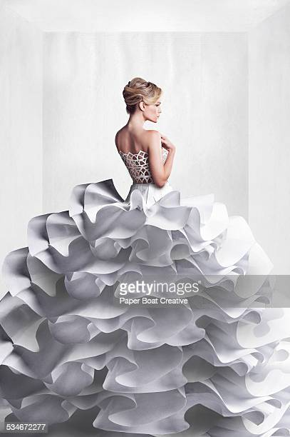 Beautiful lady in white paper craft wedding dress