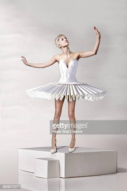 Beautiful lady in white papercraft ballerina dress