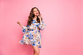 Beautiful lady overjoyed by warm spring breeze dream of romantic date wear cute floral dress isolated pink background