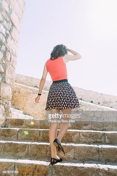 beautiful lady walking upstairs outdoors - leg waxing stock pictures, royalty-free photos & images