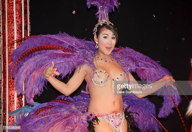 CONTENT] beautiful ladyboy performer onstage at a cabaret in Bangkok Thailand