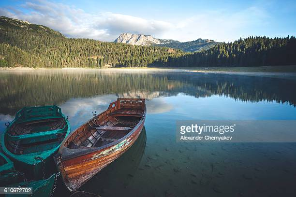 Beautiful lake and old boats in the mountains