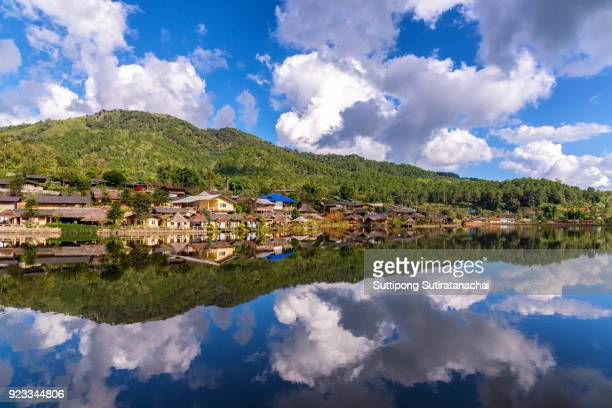 beautiful lake and sky view of village and mountain reflection in meahongson northern of Thailand
