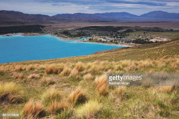 Beautiful Lake Tekapo surrounding by lake and mountains.