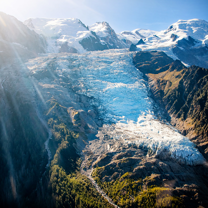 Beautiful landscape aerial view of Bossons Glacier from Mont Blanc massif in french Alps mountains in autumn 1132098043