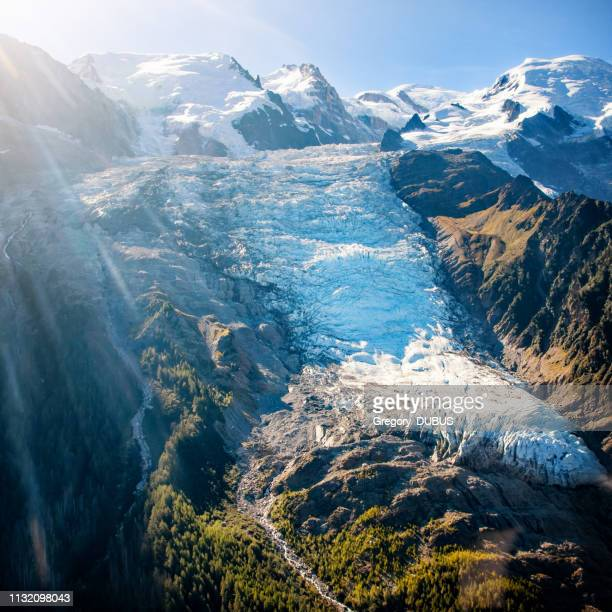 beautiful landscape aerial view of bossons glacier from mont blanc massif in french alps mountains in autumn - monte bianco foto e immagini stock