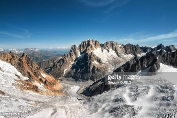 beautiful landscape aerial view of old glacier from mont blanc massif in french alps mountains in autumn - monte bianco foto e immagini stock