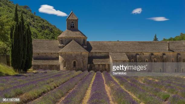 Beautiful landscape lavender field and an ancient monastery Abbaye Notre-Dame de Senanque (Notre-Dame de Senanque abbey) in Vaucluse, France