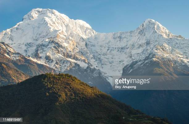 beautiful landscape of annapurna range includes mt.annapurna south and mt.hiunchuli. - annapurna south stock photos and pictures