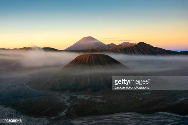 beautiful landscape of mount bromo during sunrise in bromo tengger semeru national park, east java, indonesia - bromo tengger semeru national park stock pictures, royalty-free photos & images