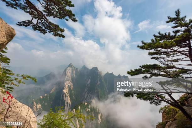 beautiful landscape of mountain huashan, one of the most popular travel destinations in china at sunset, shaanxi province. - lotus flower peak stock pictures, royalty-free photos & images