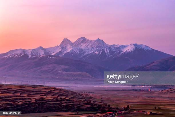 beautiful landscape snow mountain at sichuan province - twilight stock pictures, royalty-free photos & images