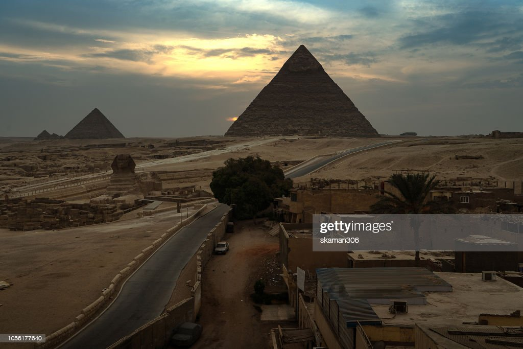 CAIRO, GIZA - SEPTEMBER 30: beautiful landscape sunset  the Great Pyramids of Giza on September, 2018 in Cairo, Egypt : Stock Photo