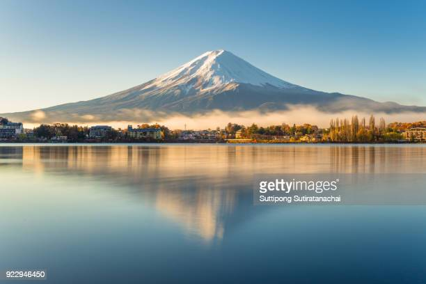 beautiful landscape view of fuji mountain in morning and mist with reflection in kawakuchigo lake, fuji is most travel destination in japan - mount fuji stock photos and pictures