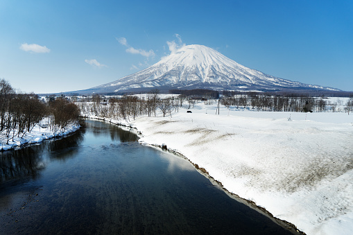 Beautiful landscape view of little fuji Mountain Yotei and village near Niseko Hokkaido Japan - gettyimageskorea