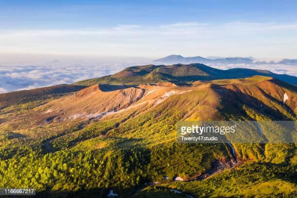 beautiful landscape view of mount shirane at japan's highest national highway point in gunma, japan - landelement stockfoto's en -beelden