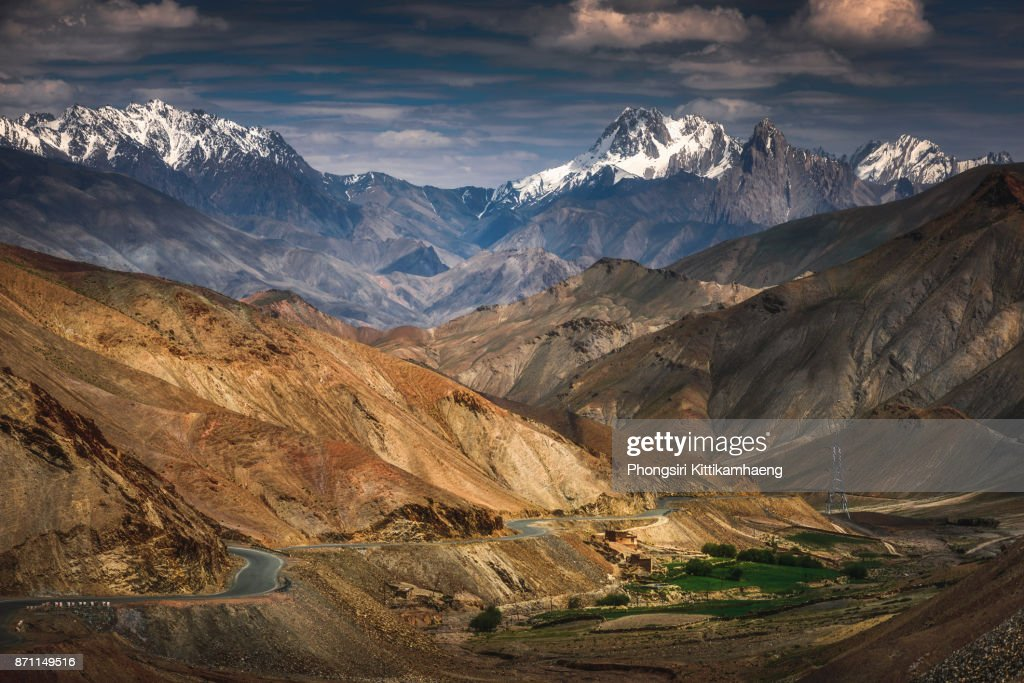 WARM: Beautiful Landscape view of snow-capped mountain on the way back to Leh City, India : Stock Photo
