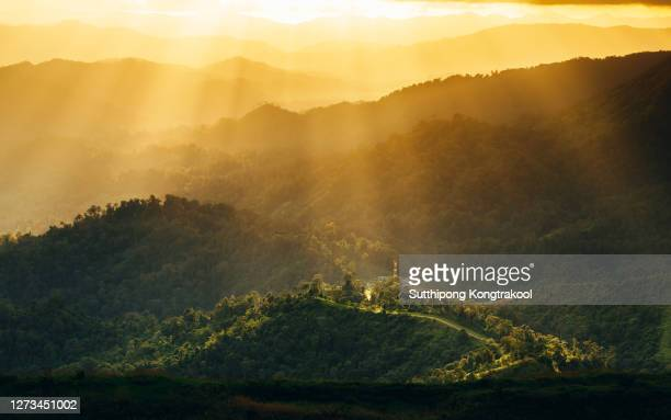 beautiful landscape view of sunset over the mountain at thailand. light phenomenon - light natural phenomenon stock pictures, royalty-free photos & images