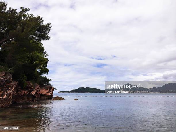 beautiful landscape with adriatic sea and the mountains in montenegro near the city budva. travel background. nature background. cruise trip. summer holidays. image with copy space. - países del golfo fotografías e imágenes de stock