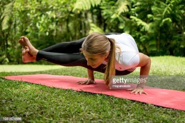Beautiful latin american woman doing yoga outdoors