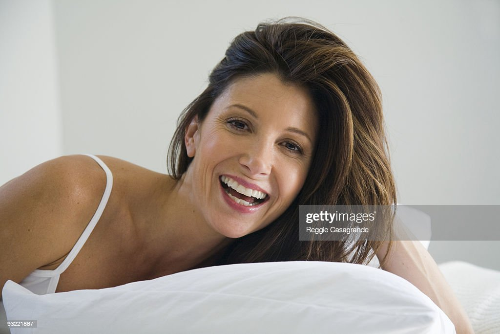 Beautiful Latin Woman Laying In Bed High-Res Stock Photo
