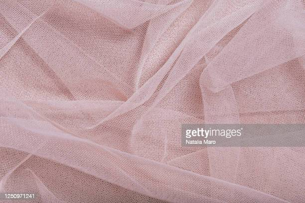 beautiful layers of delicate pink tulle fabric background. - チュール生地 ストックフォトと画像