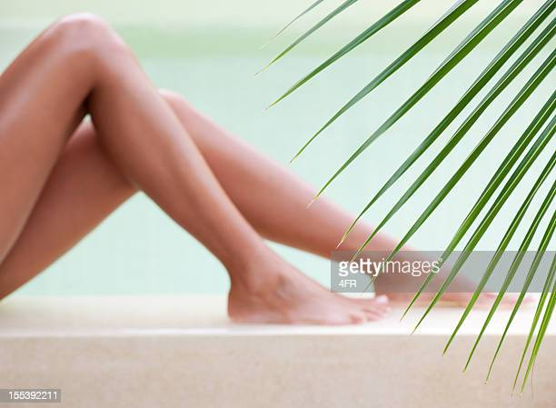 Beautiful legs relaxing by the pool (XXXL)